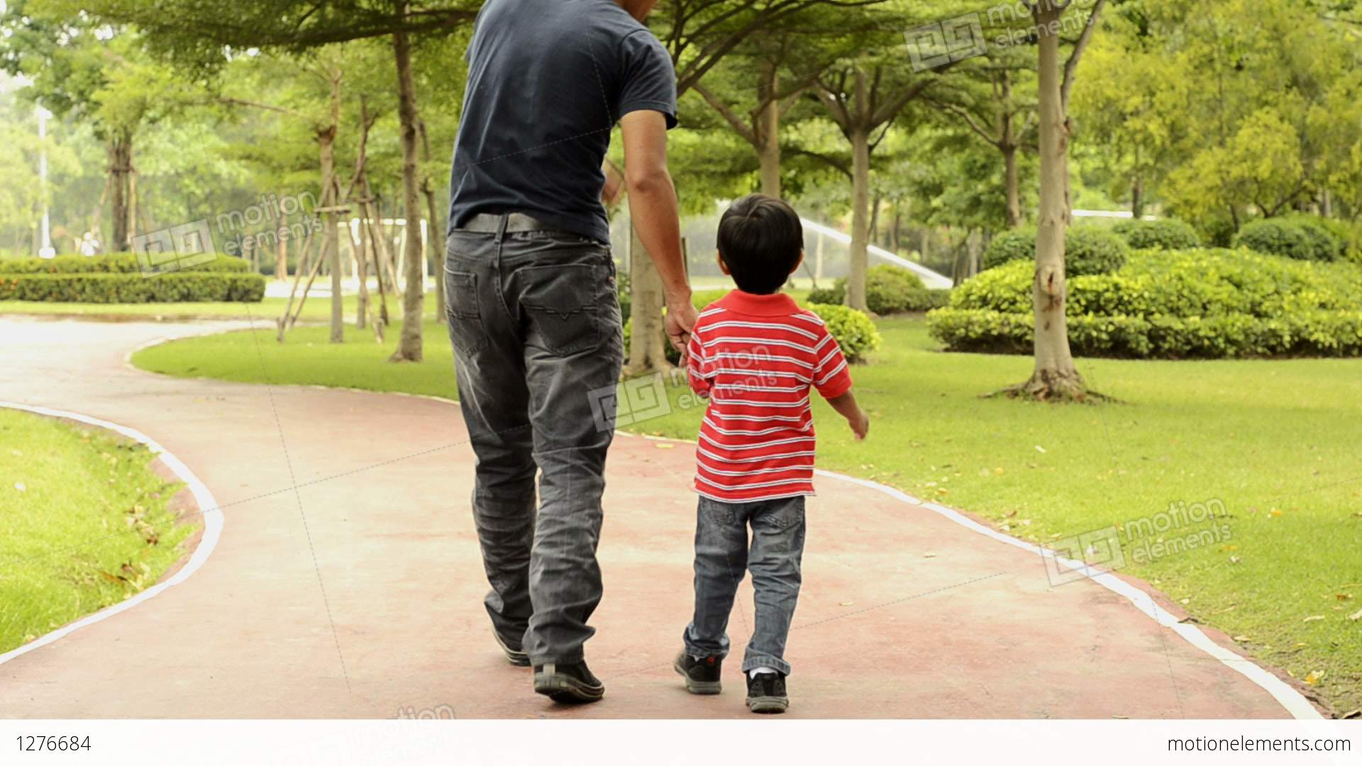 Dad And Son Walking Father And Son Walking Together Stock