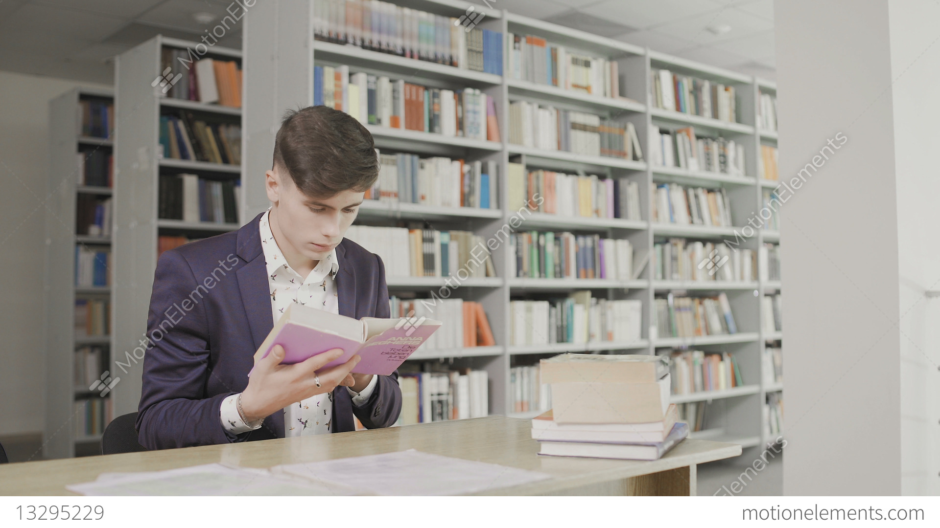 Young Male Student Reading A Book In A Library  Man In A Suit Reading Book  On Stock video footage