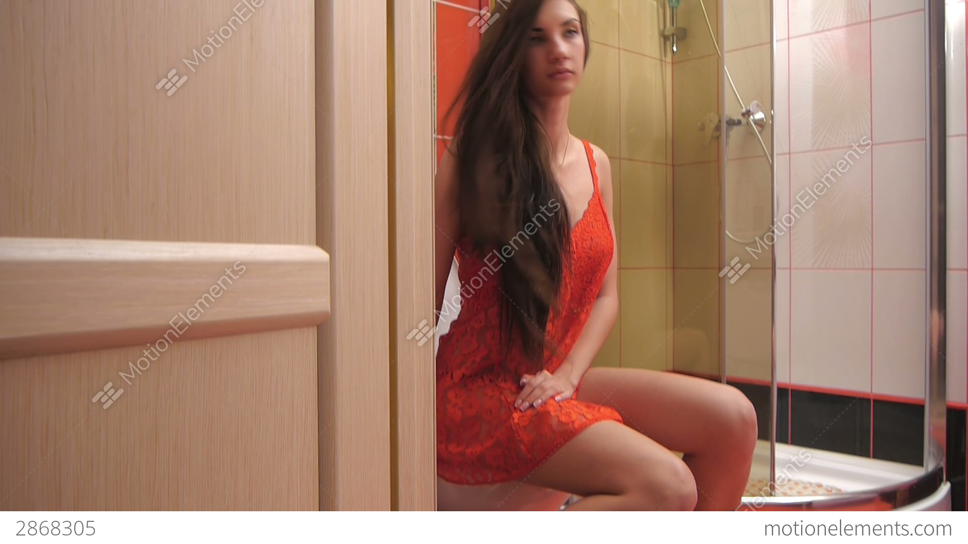Girl Sitting On The Toilet In The Bathroom Stock video ...