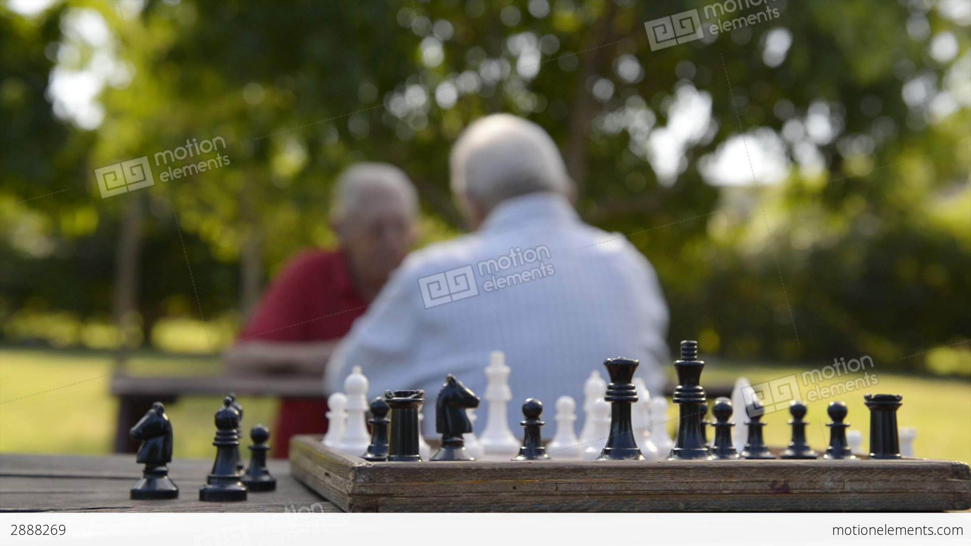 05 senior men playing chess at park and closeup of pieces stock 05 senior men playing chess at park and closeup of pieces stock video footage biocorpaavc Gallery