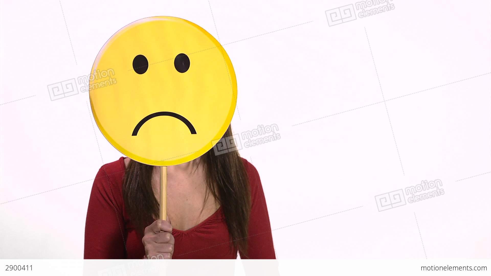 Woman holding sad face emoticon stock video footage 2900411 woman holding sad face emoticon stock video footage buycottarizona Choice Image