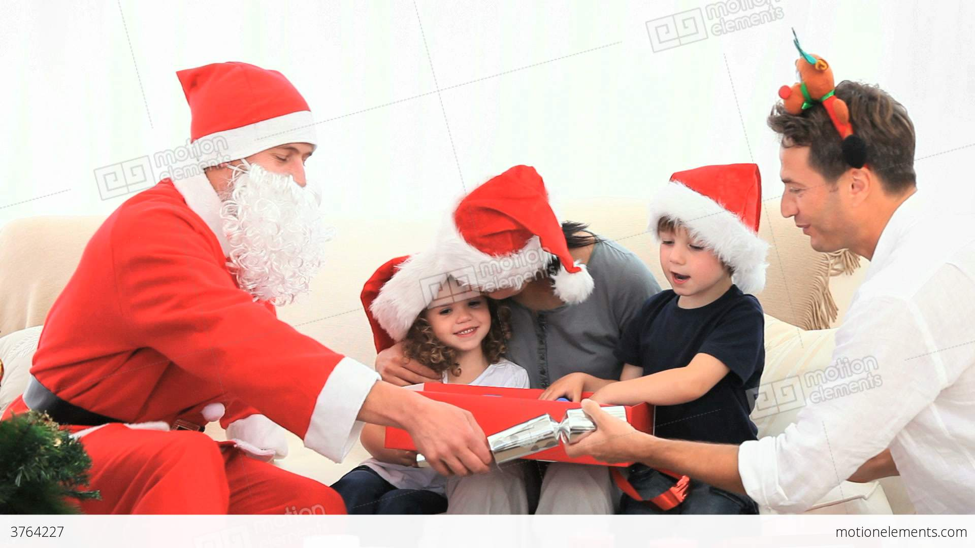 Family opening gift with santa claus stock video footage 3764227 family opening gift with santa claus stock video footage m4hsunfo Images