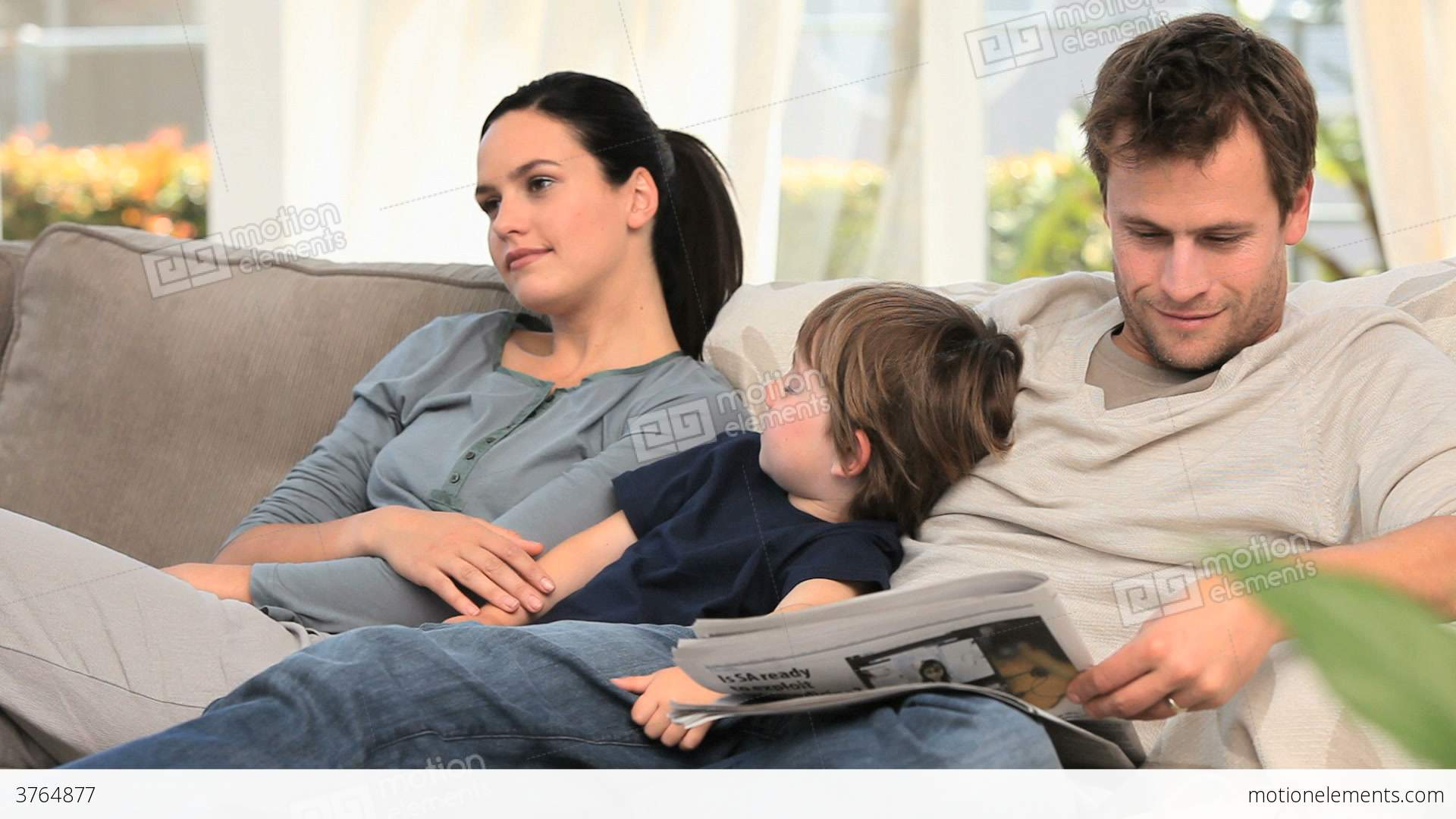Family Relaxing On The Sofa Stock Video Footage