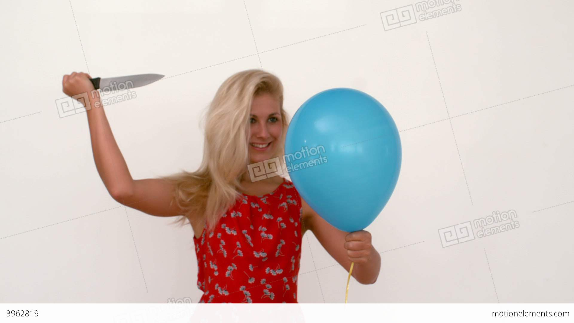 Woman Popping A Balloon With Knife Stock video footage