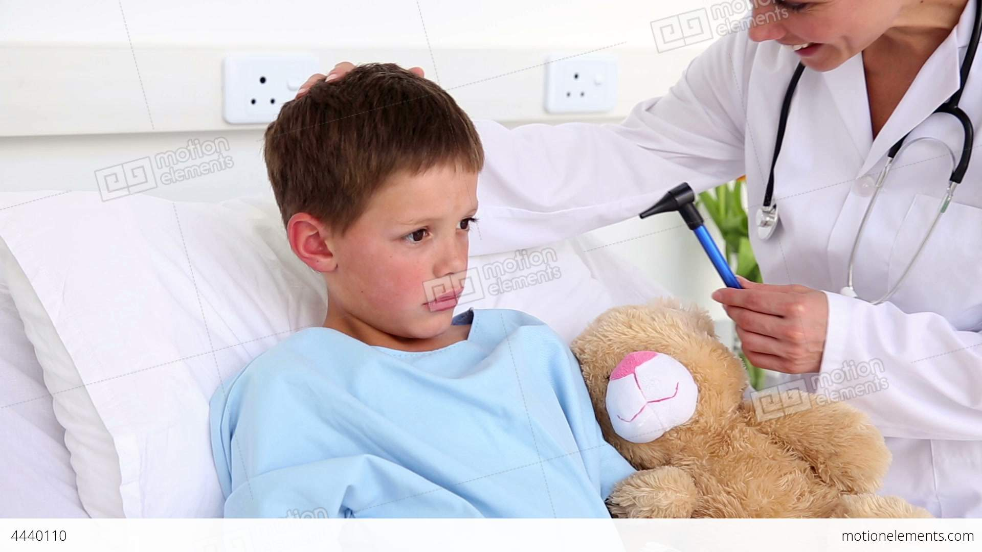 Doctor Checking The Ears Of Little Sick Boy Sittin Stock ...