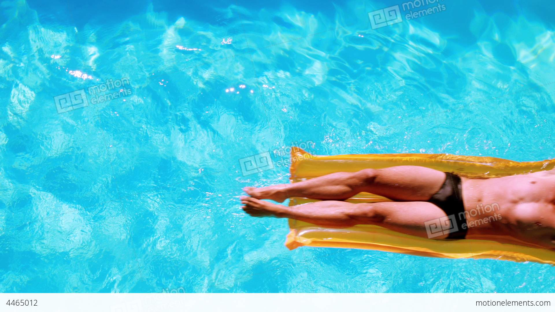 Fit Man Relaxing On Lilo In Swimming Pool Stock Video Footage
