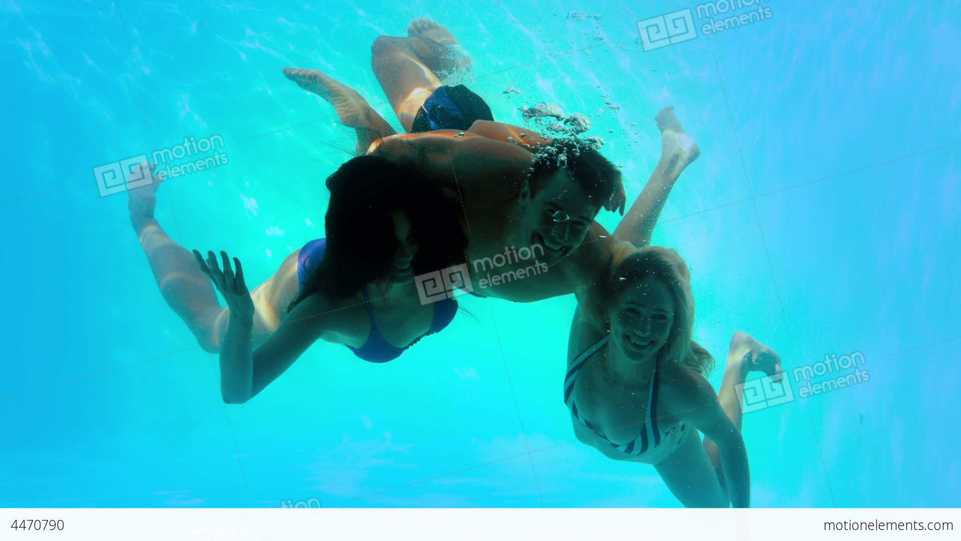 Friends Swimming Underwater In Pool Together Stock video ...