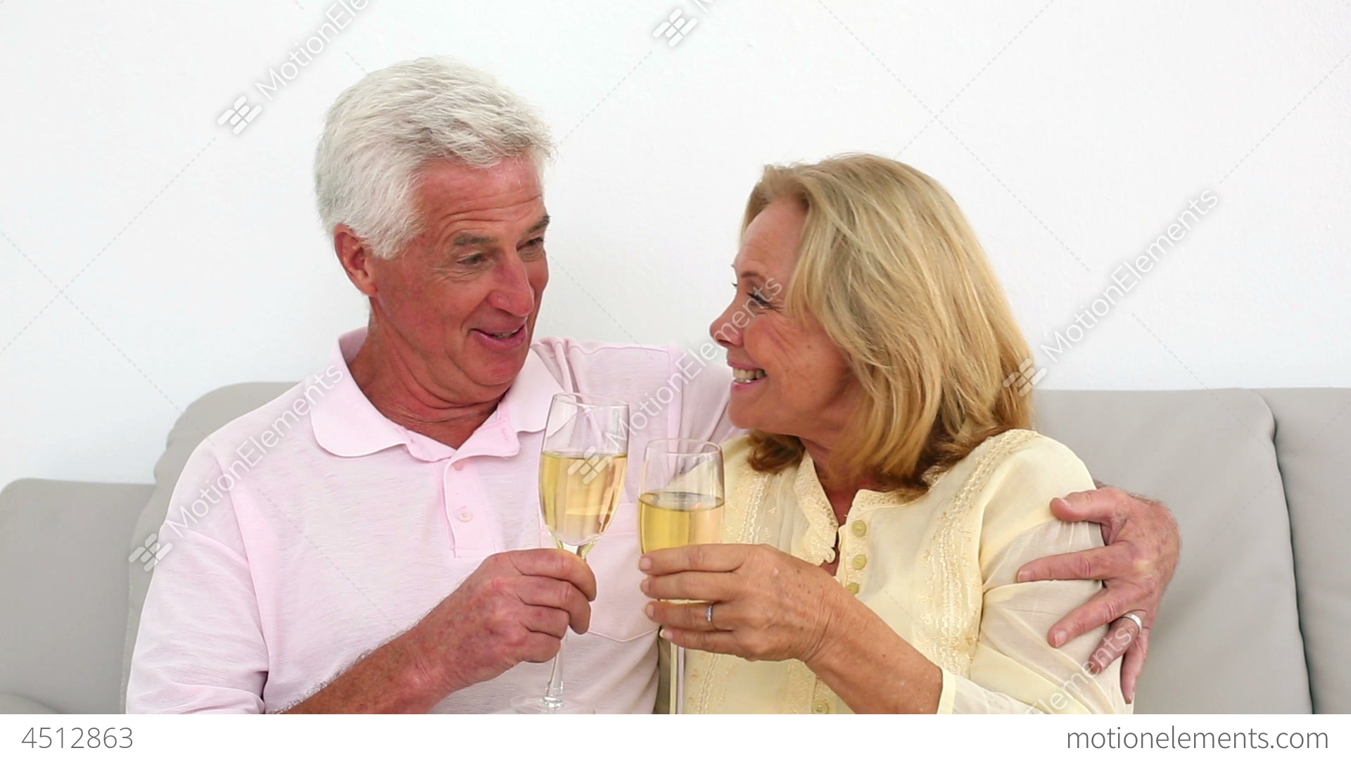 Couple drinking on couch