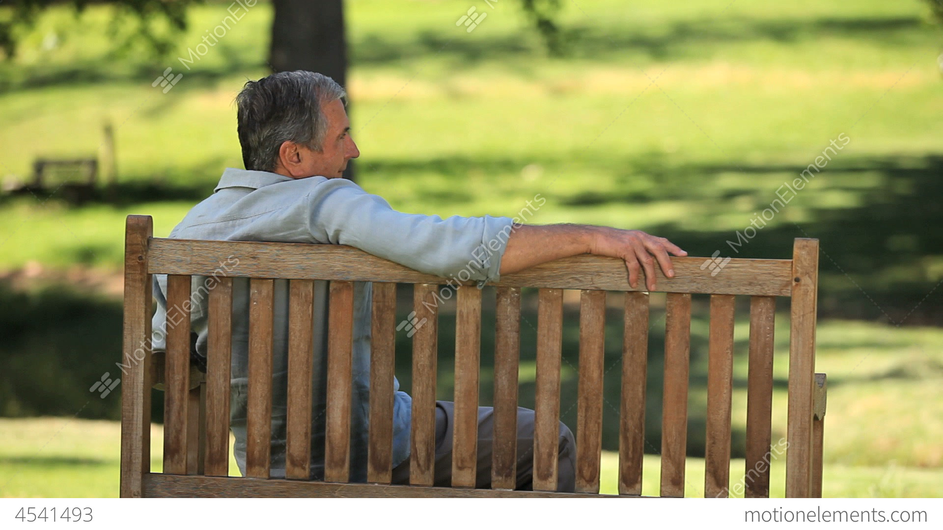Superior Video Bench Part - 4: Old Man Relaxing On A Bench Stock Video Footage
