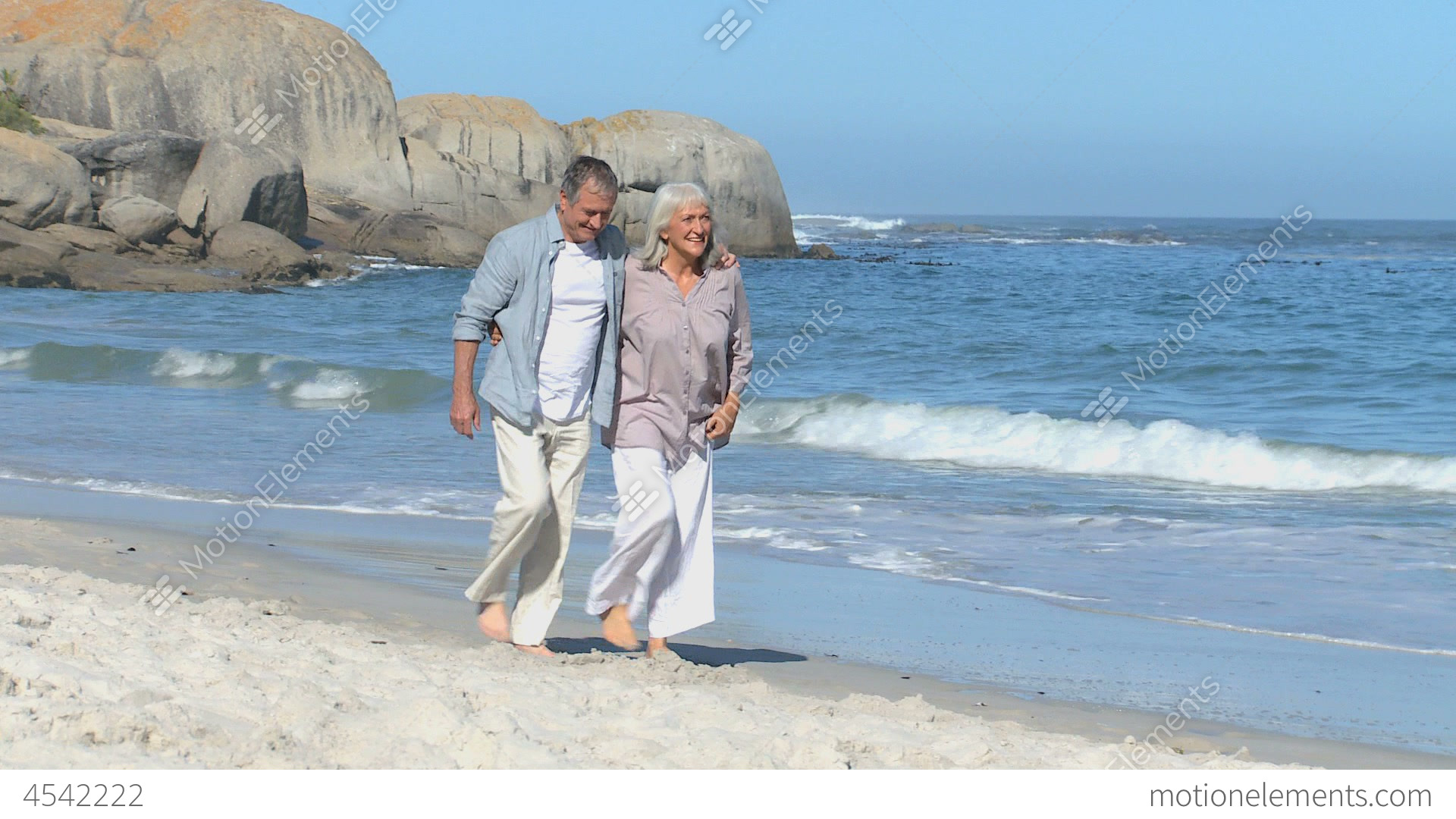 Progressive Near Me >> Elderly Couple Walking Along The Beach Stock video footage | 4542222