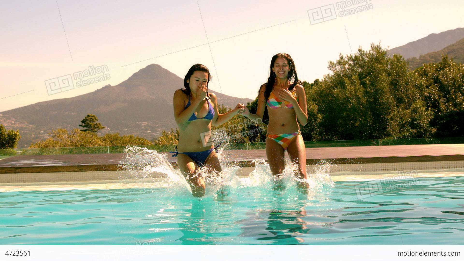 Cute Friends Jumping Into Swimming Pool Together Stock Video Footage