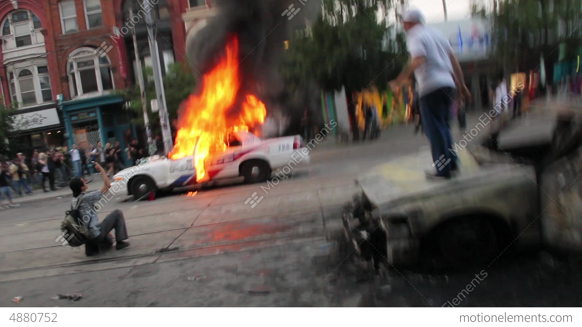 Rioters Jump And Set Police Cars On Fire Hd Stock Video Footage