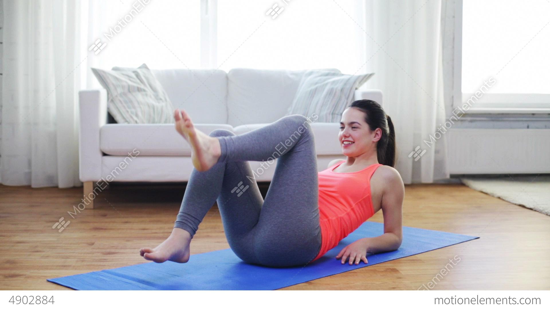 Smiling Teenage Girl Doing Exercise For Legs Stock video ...