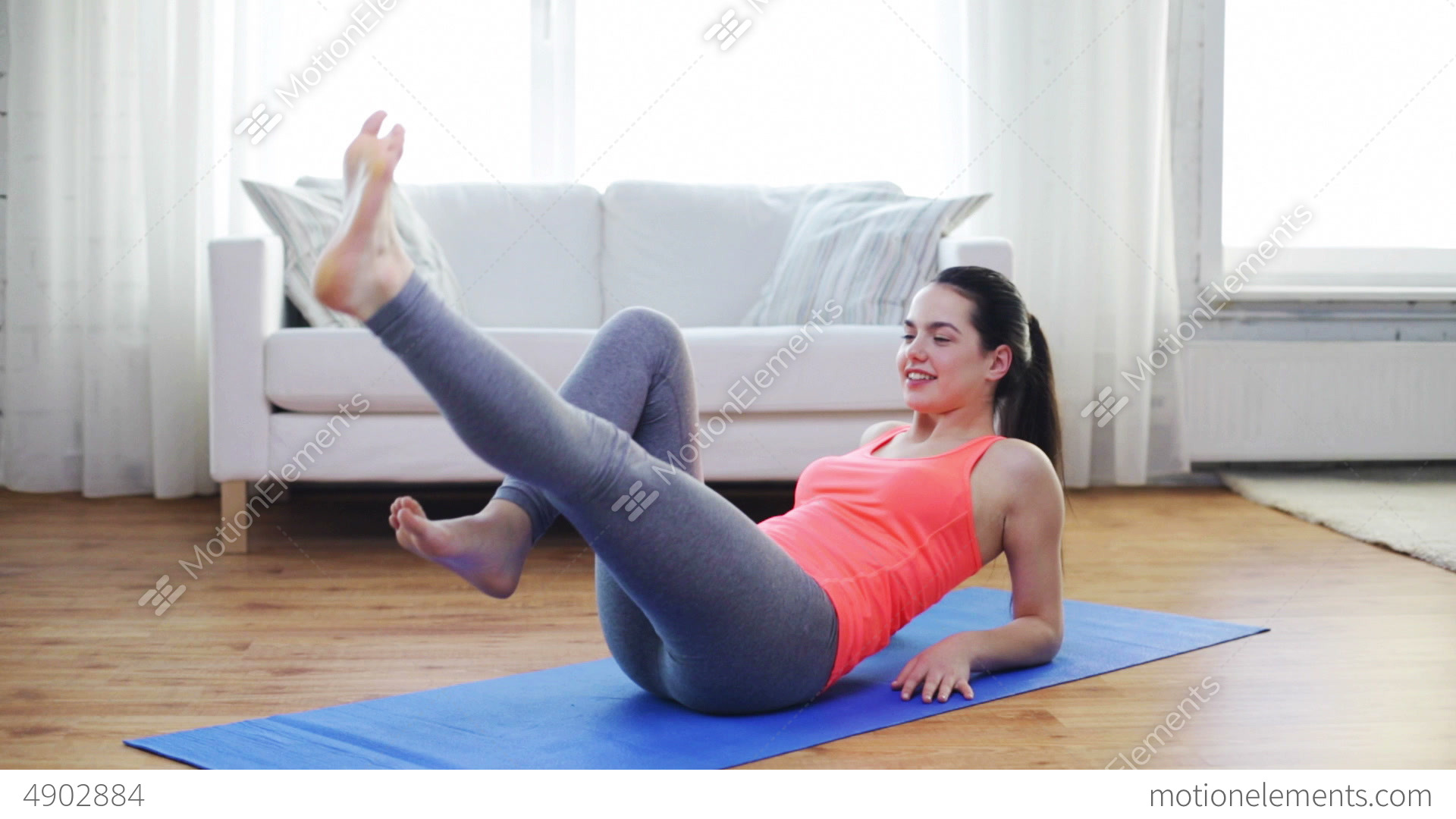 smiling teenage girl doing exercise for legs Stock Video Footage