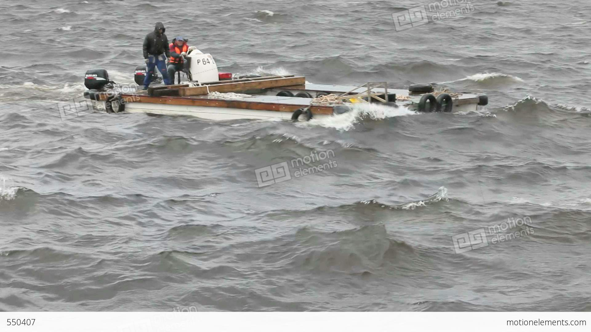Two Men On A Motor Catamaran Sailing In A Storm Stock