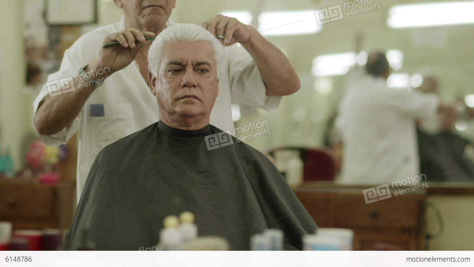 Elderly Barber Giving Haircut To Customer In Beauty Parlor Stock