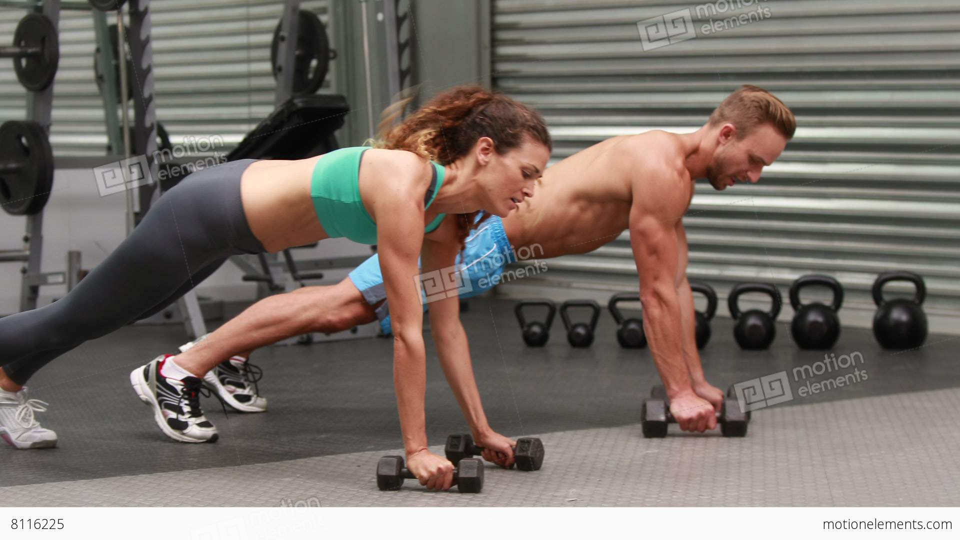 Fit couple doing dumbbell rows at crossfit gym stock video footage fit couple doing dumbbell rows at crossfit gym stock video footage platinumwayz