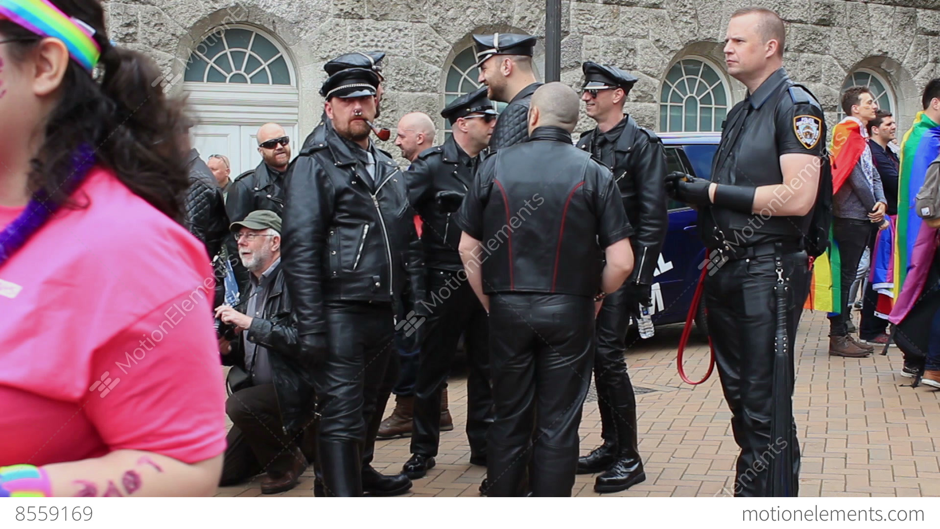 Fetishism - group of men in leather suits during gay pride Stock Video  Footage