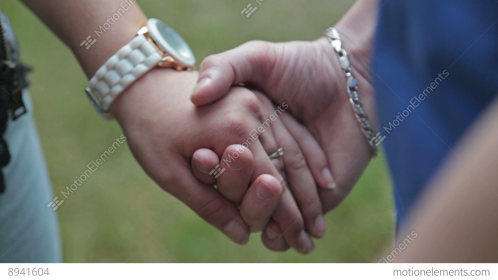 Two People Holding Hands Stock video footage | 8941604