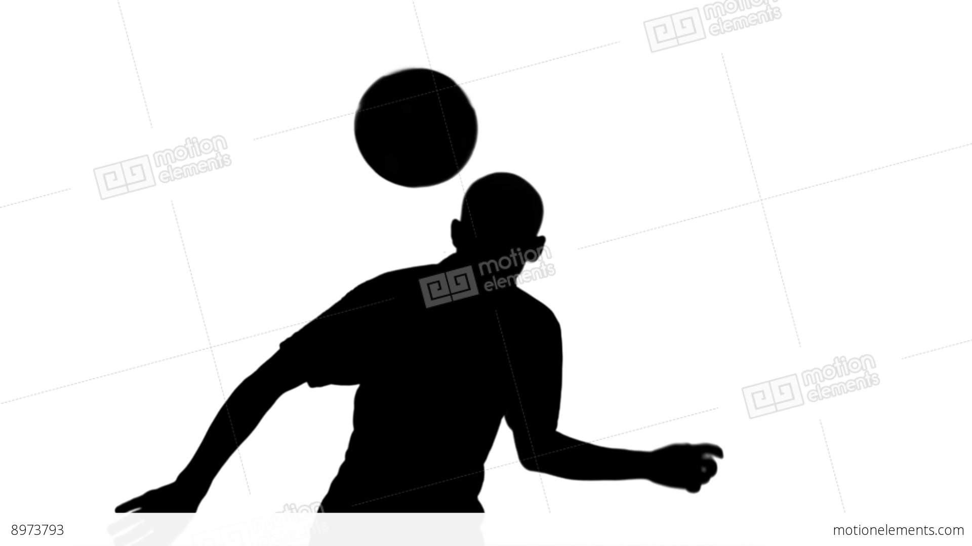 silhouette of football player heading the ball stock video footage