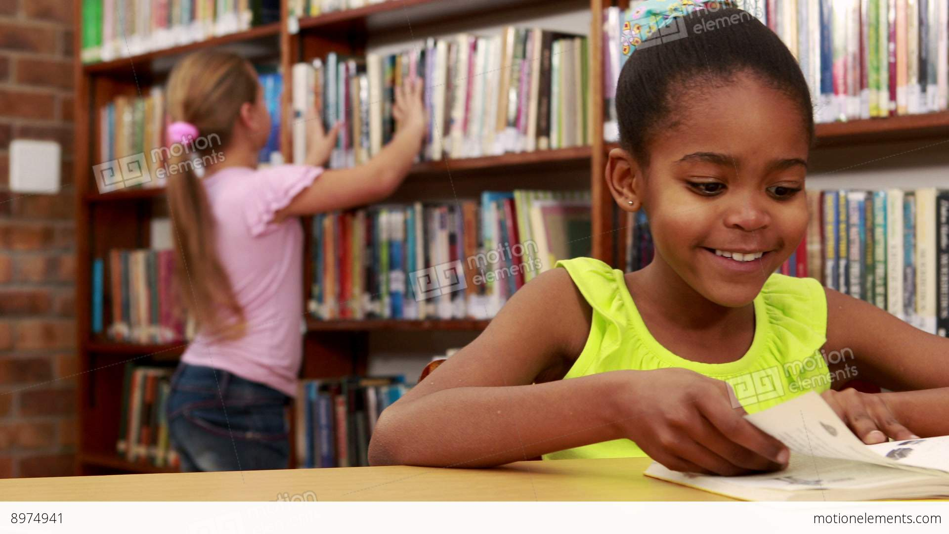 Girl reading book stock