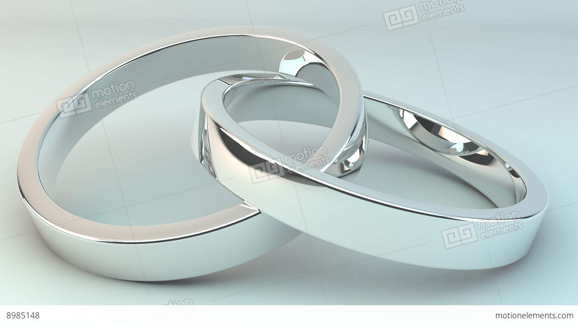wedding rings joined together against a white background