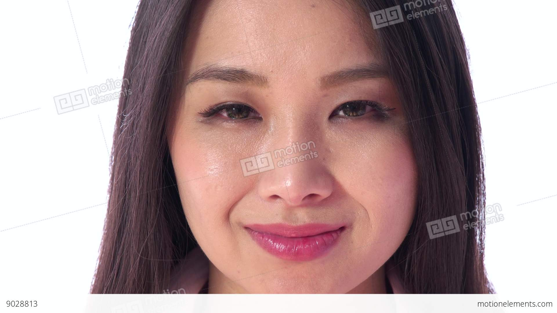 face of happy young asian japanese woman smiling at camera stock