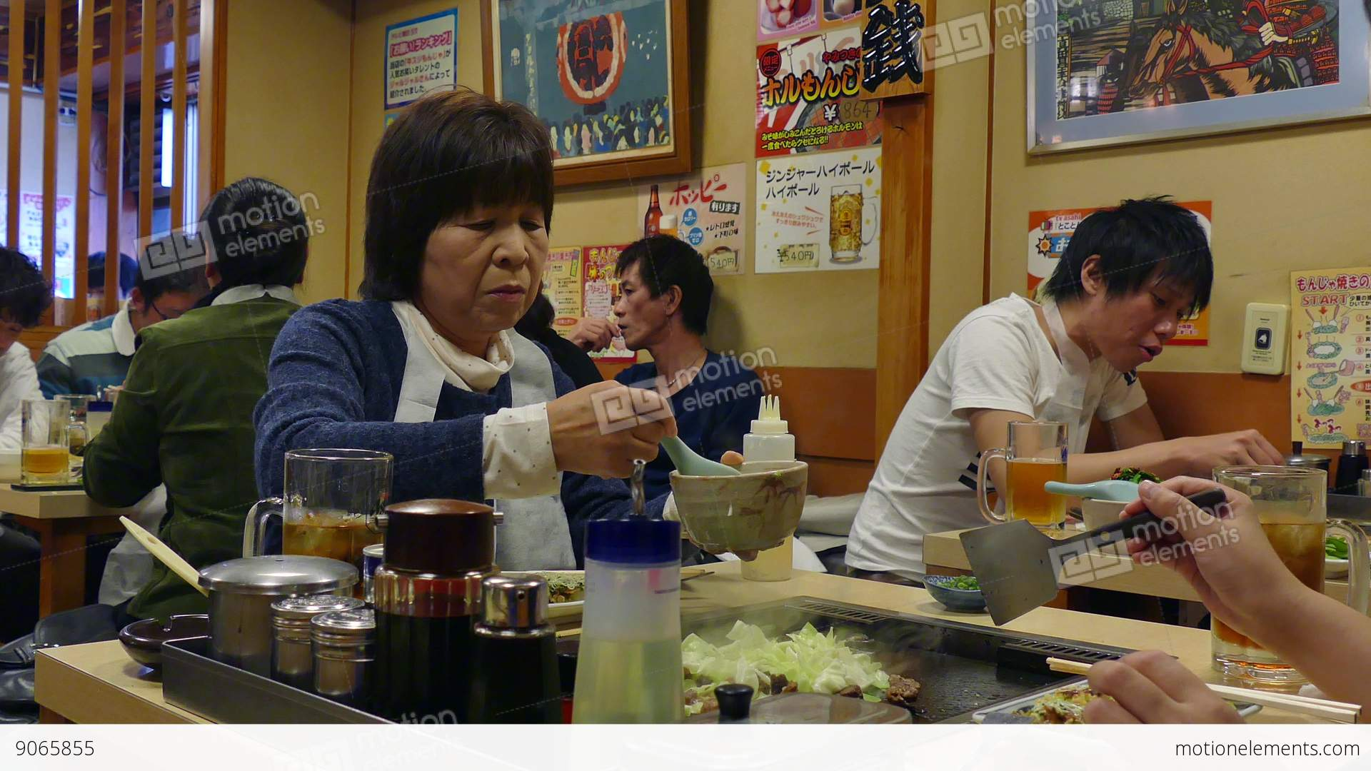Asian Japanese People Eating Food In Traditional Restaurant Tokyo