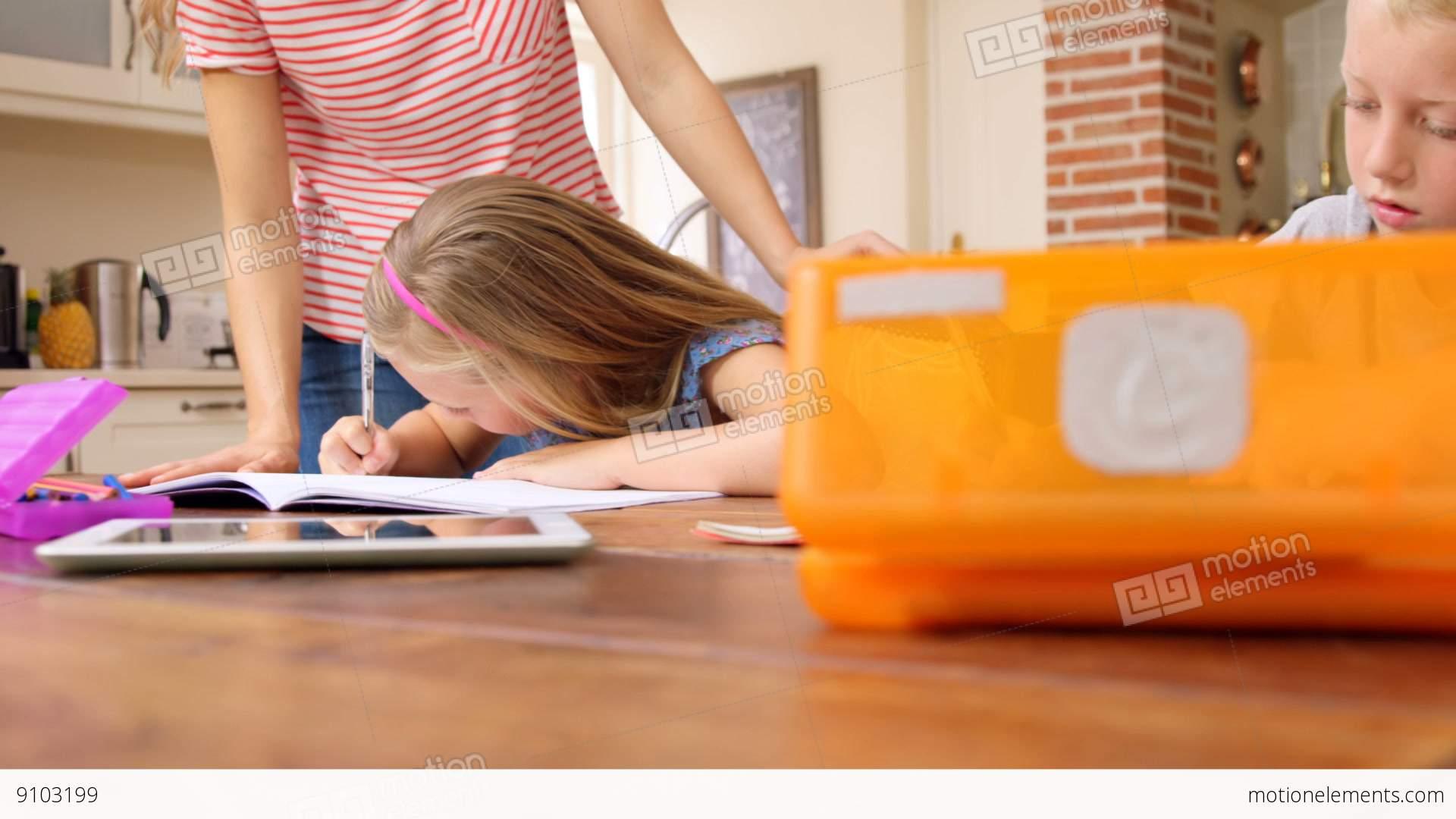 parents and children doing homework together banco de