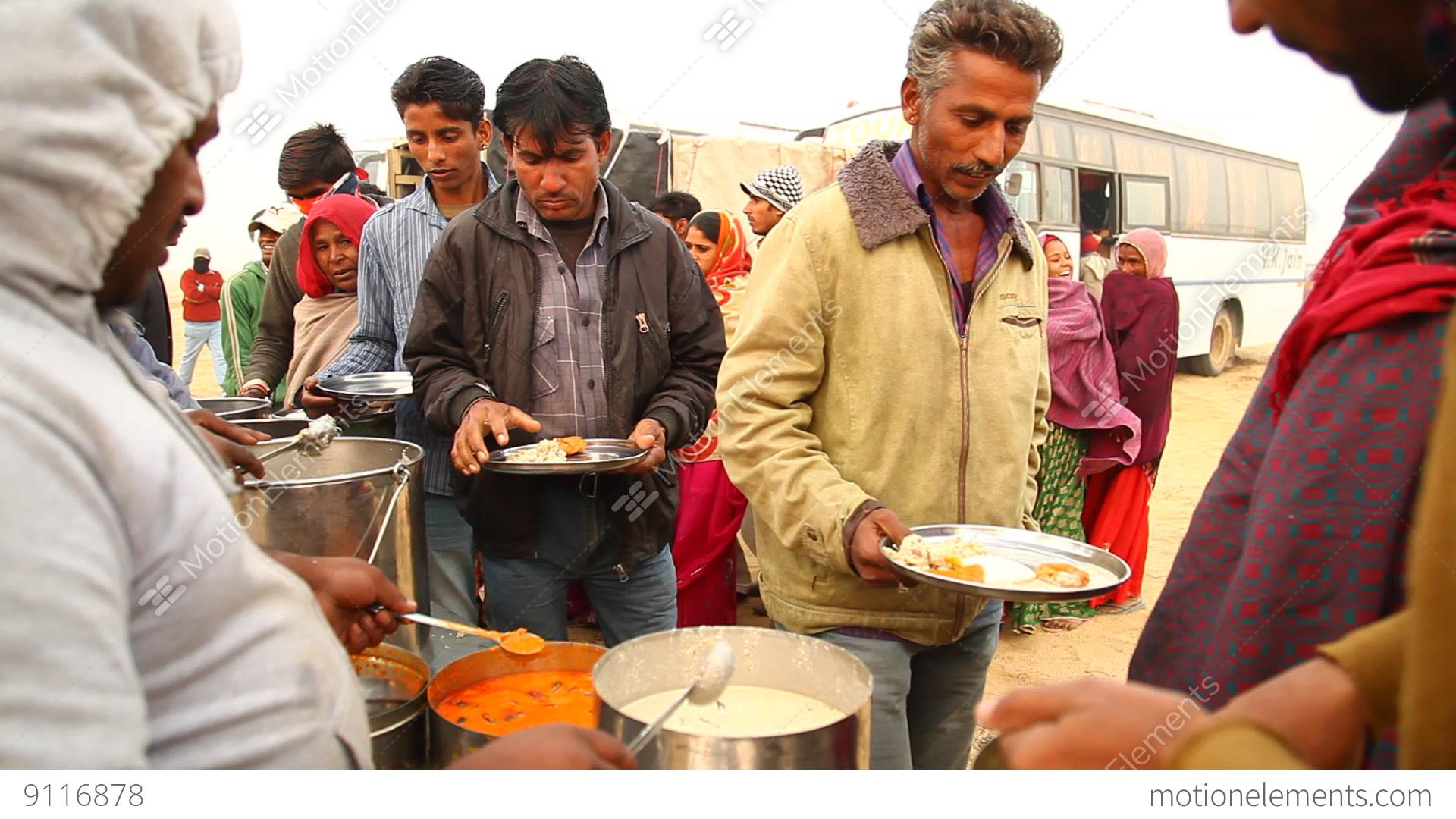 poor people eating food in desert stock video footage