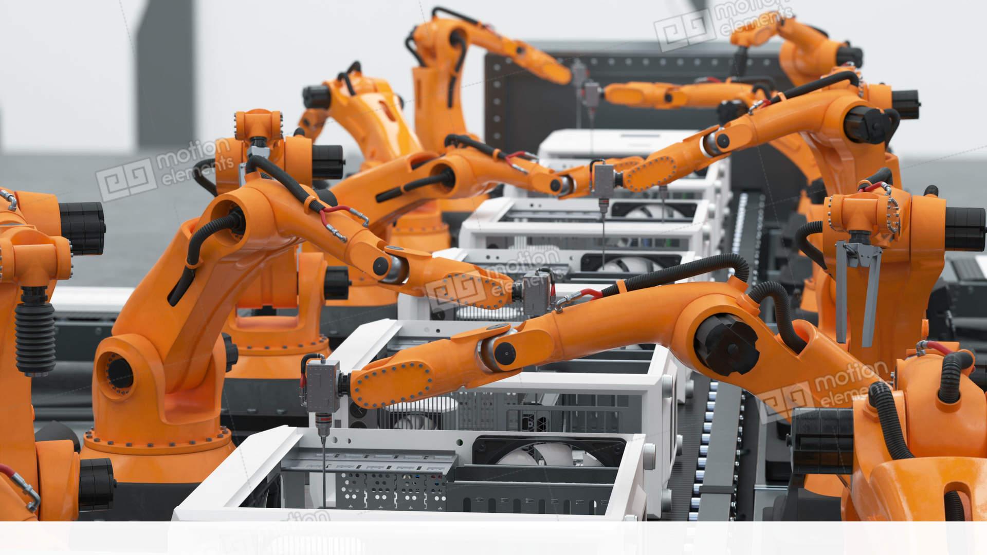 a lot of robotic arms assembling computers on conveyor belt modern