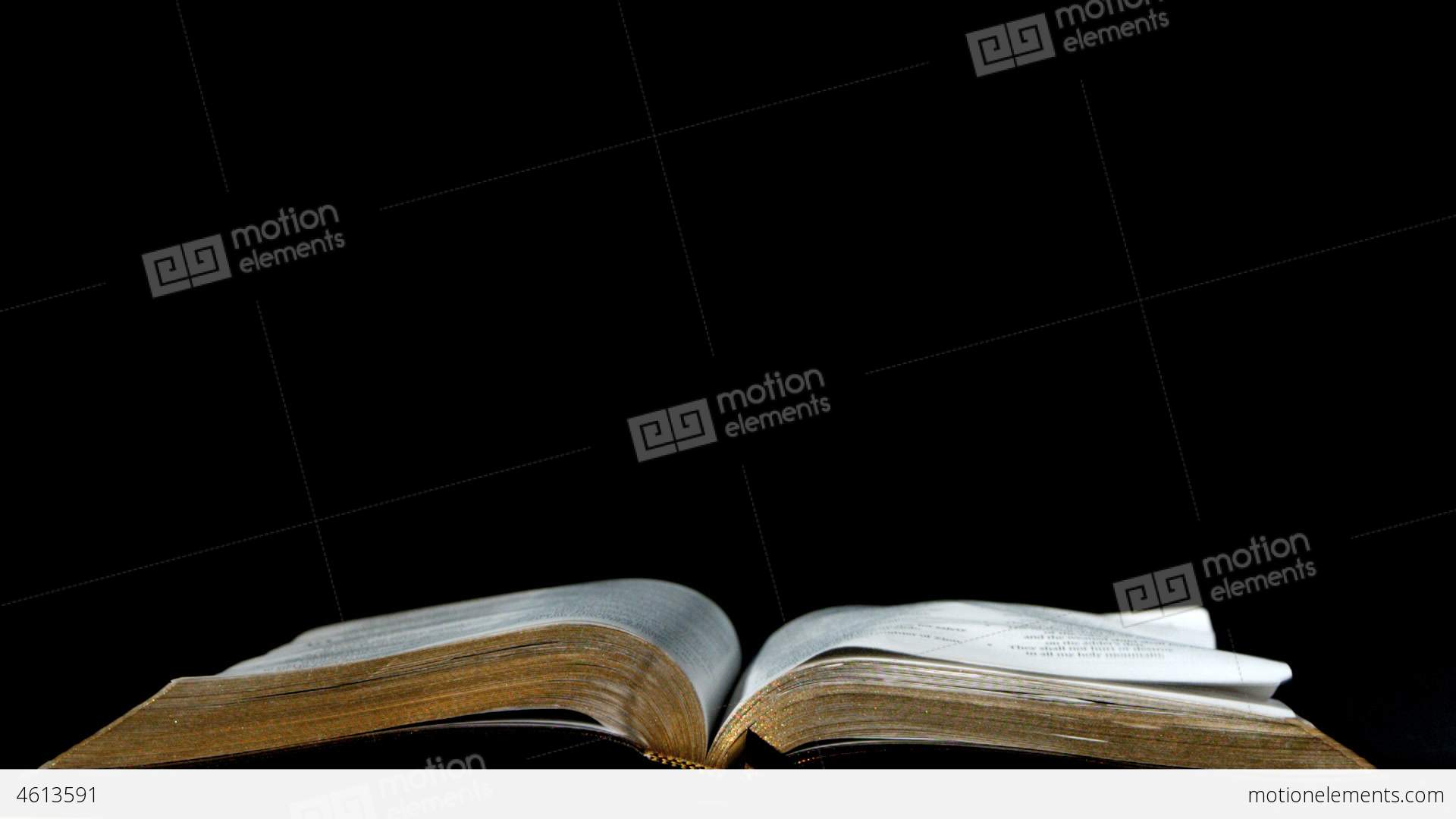 pages of the bible turning in the wind on black ba stock video