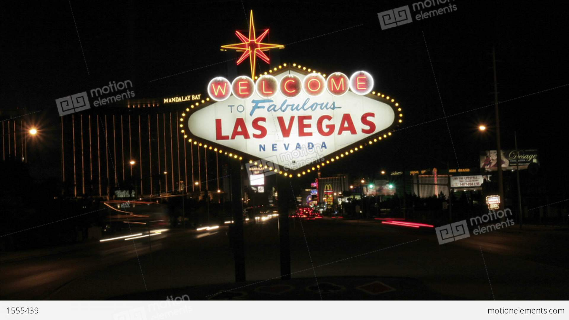 the famous welcome to fabulous las vegas sign lights up the night sky stock video footage 1555439. Black Bedroom Furniture Sets. Home Design Ideas
