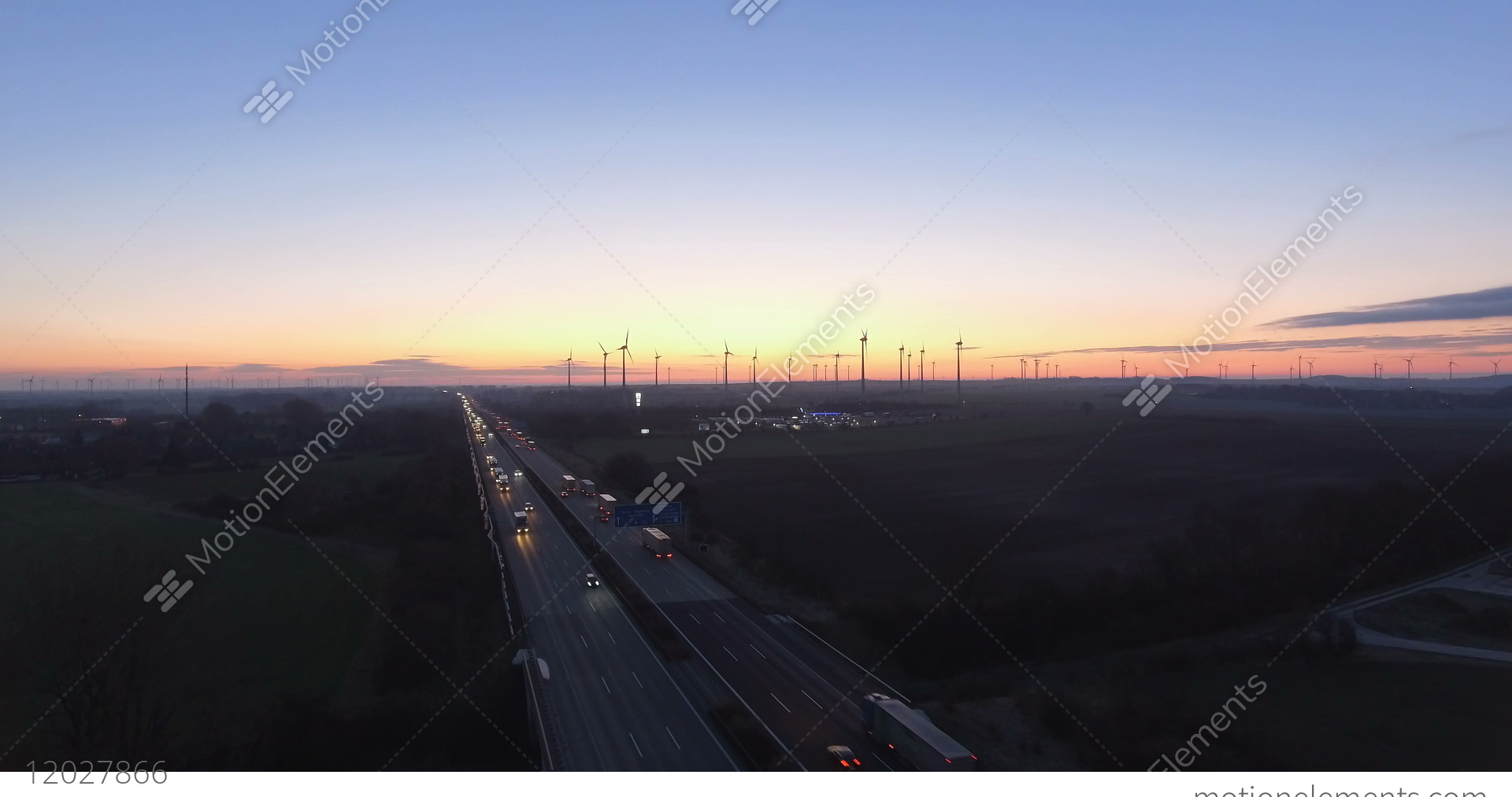 Morning Light Over Rural Highway Traffic, Wind Turbines, From Bird's Eye  View Stock video footage