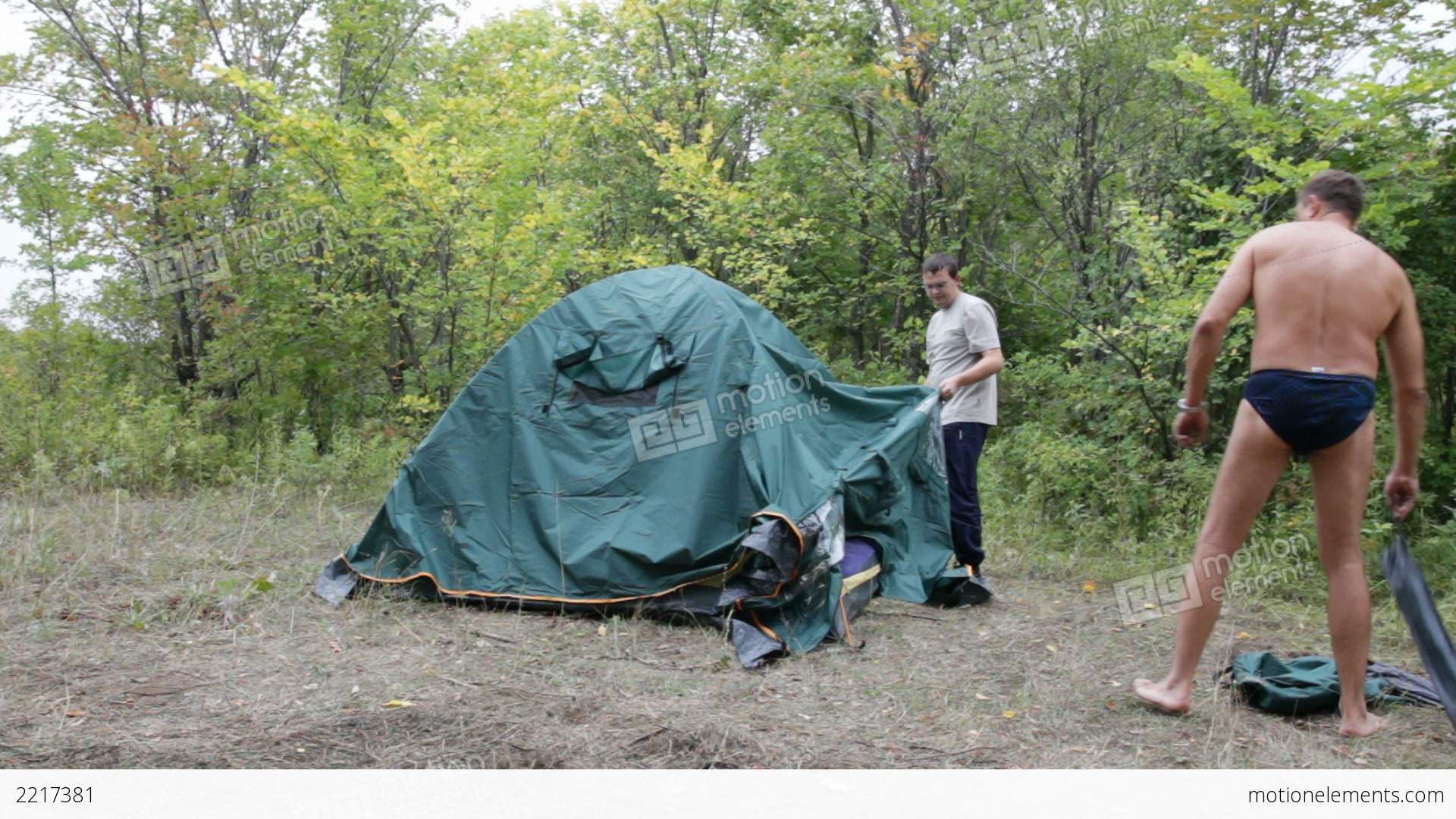 Two men removed a tent Stock Video Footage & Two Men Removed A Tent Stock video footage | 2217381