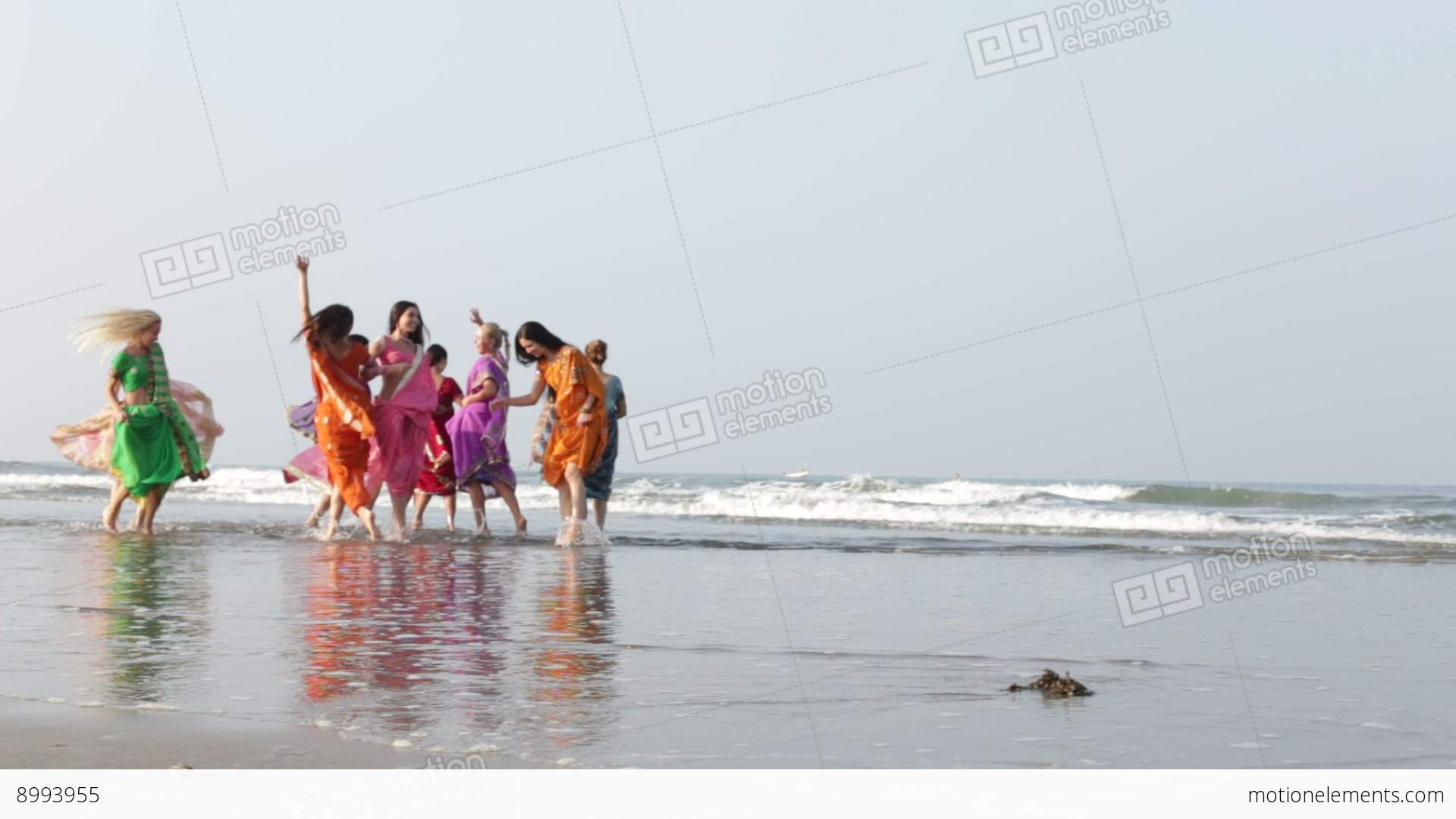 S In Indian National Dresses Run Out To Sand Beach Dance Stock