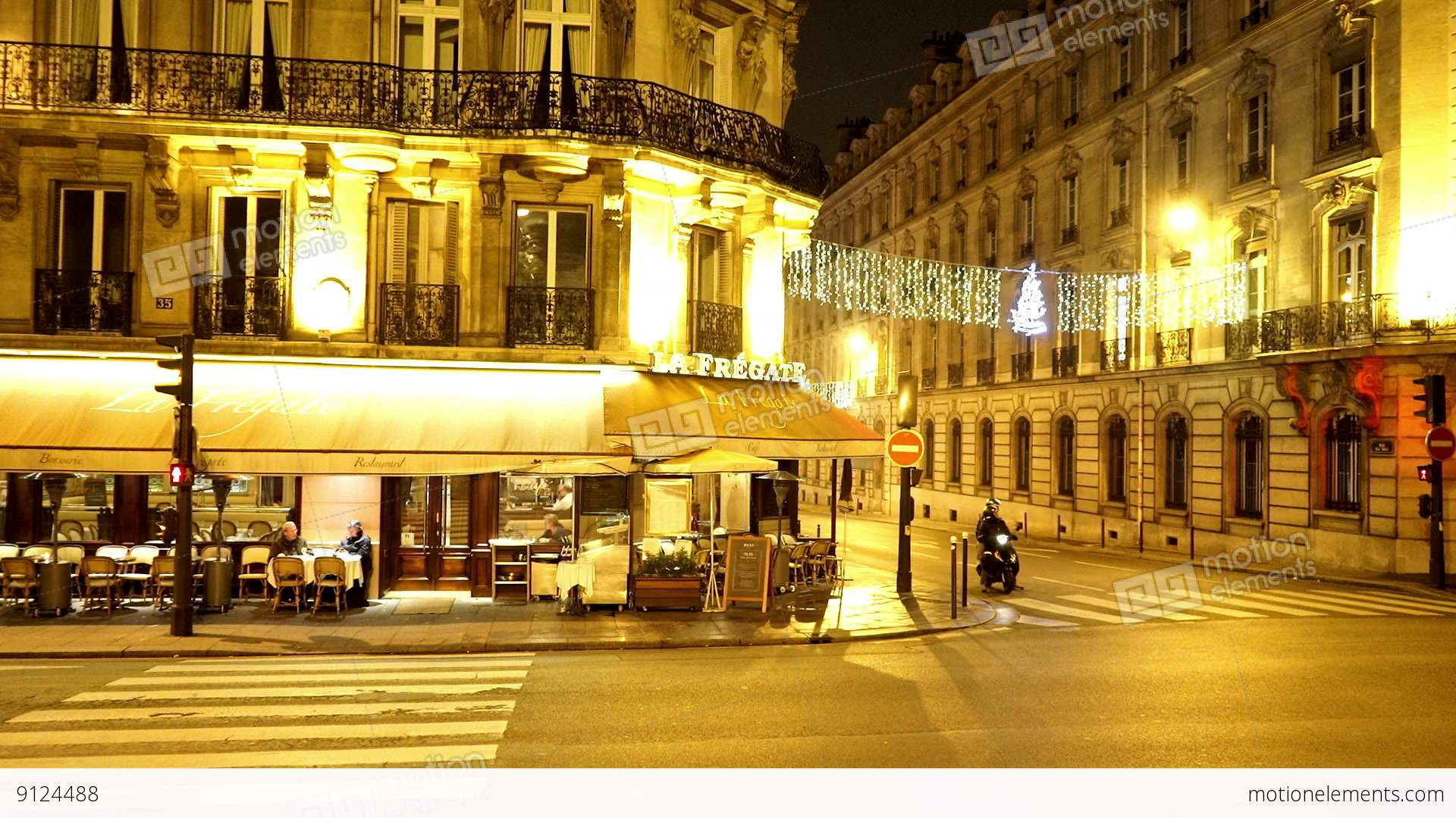 typical street view in paris by night stock video footage