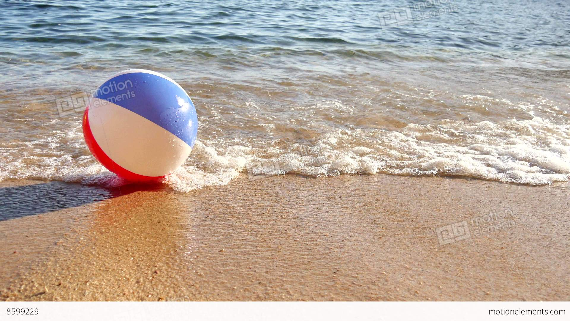 Beach Ball At The Mercy Of The Waves Stock video footage ...
