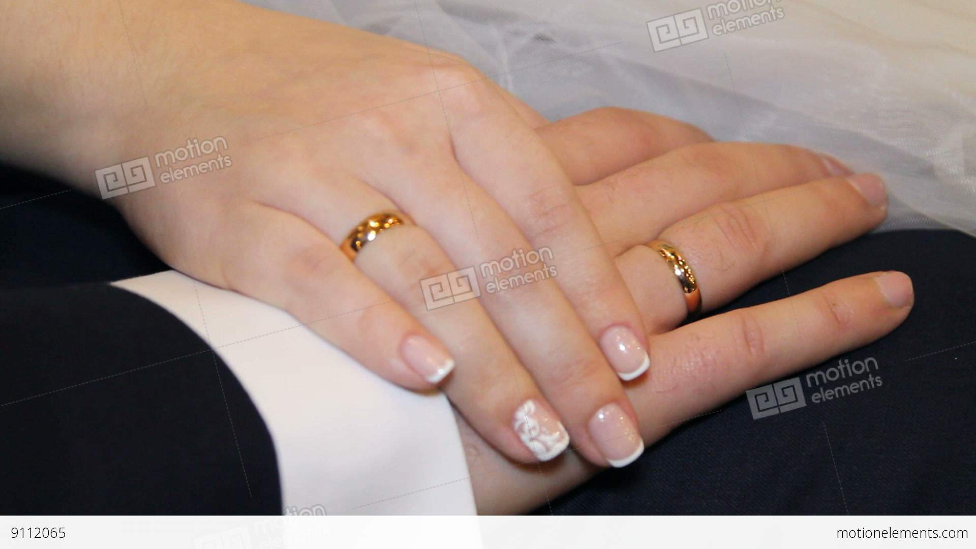 Hands Of Bride And Groom And Wedding Rings Stock video footage 9112065